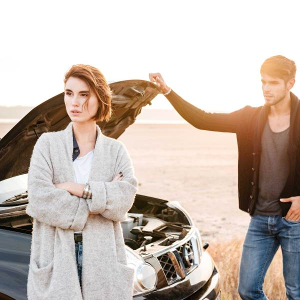 graphicstock-young-casual-couple-standing-near-broken-car-with-open-hood-outdoors_HddB5RdLne_1534540101697.jpg