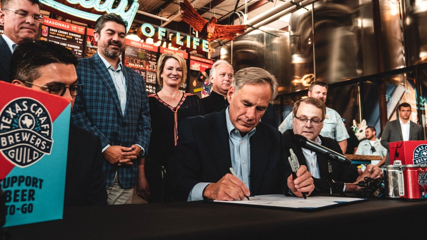 governor abbott signs beer to go law(1)_1560807398244.jpg.jpg